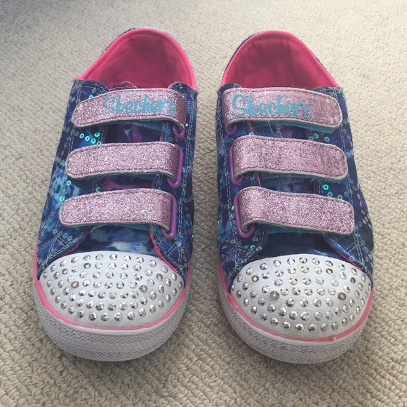 Skechers Twinkle Toes light up shoes.